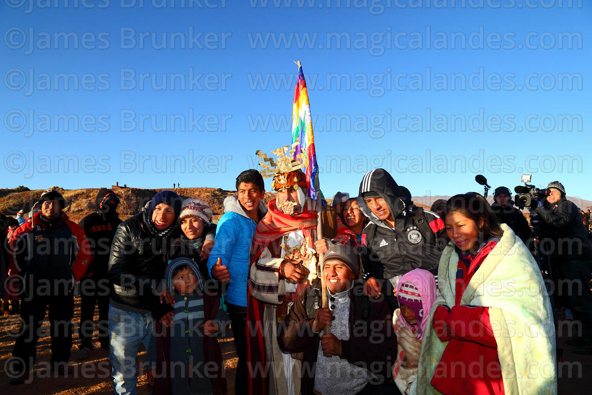 A Bolivian family have their photo taken with a man dressed as a Tiwanaku leader during Aymara New Year celebrations, Tiwanak...