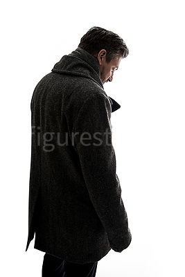A silhouetted mystery man in a big winter coat – shot from eye level.