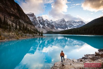 Man admiring Moraine lake at sunset, Banff, Canada