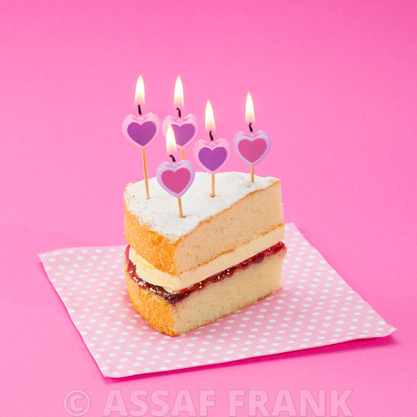Cake slice on pink background