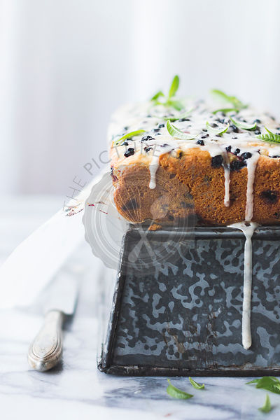 Iced berry cake with lemon verbena leaves