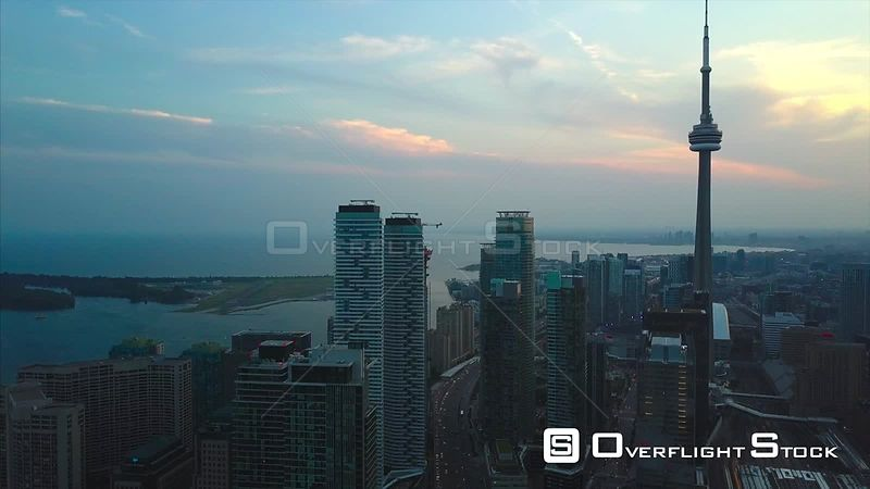 Dusk Look During Solar Eclipse. Drone Video Downtown CN Tower Toronto Ontario Canada