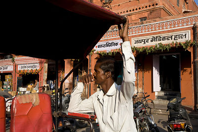 India - Jaipur - A rickshaw wallah waits for customers