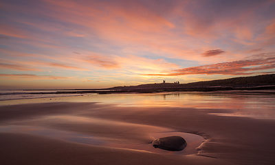 Dunstanburgh pebble at dawn