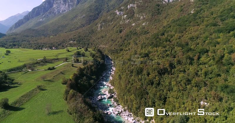 Alpine rapids, C4K aerial tilt drone view down over turquoise, soca river, in the alp nature, near Trigolov national park, on...