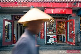 Chinese man walking in a hutong of Beijing, China