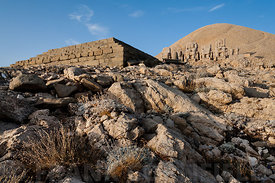 The east terrace of Mount Nemrut at sunrise with the Great alter, headless statues and tumulus behind.  The UNESCO World Heri...