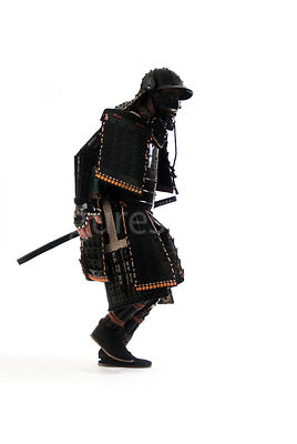A semi-silouette of a Samurai warrior running - shot from mid-level.
