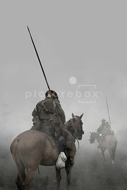 An atmospheric image of a two British cavalry soldiers on horseback on a misty morning in WW1.