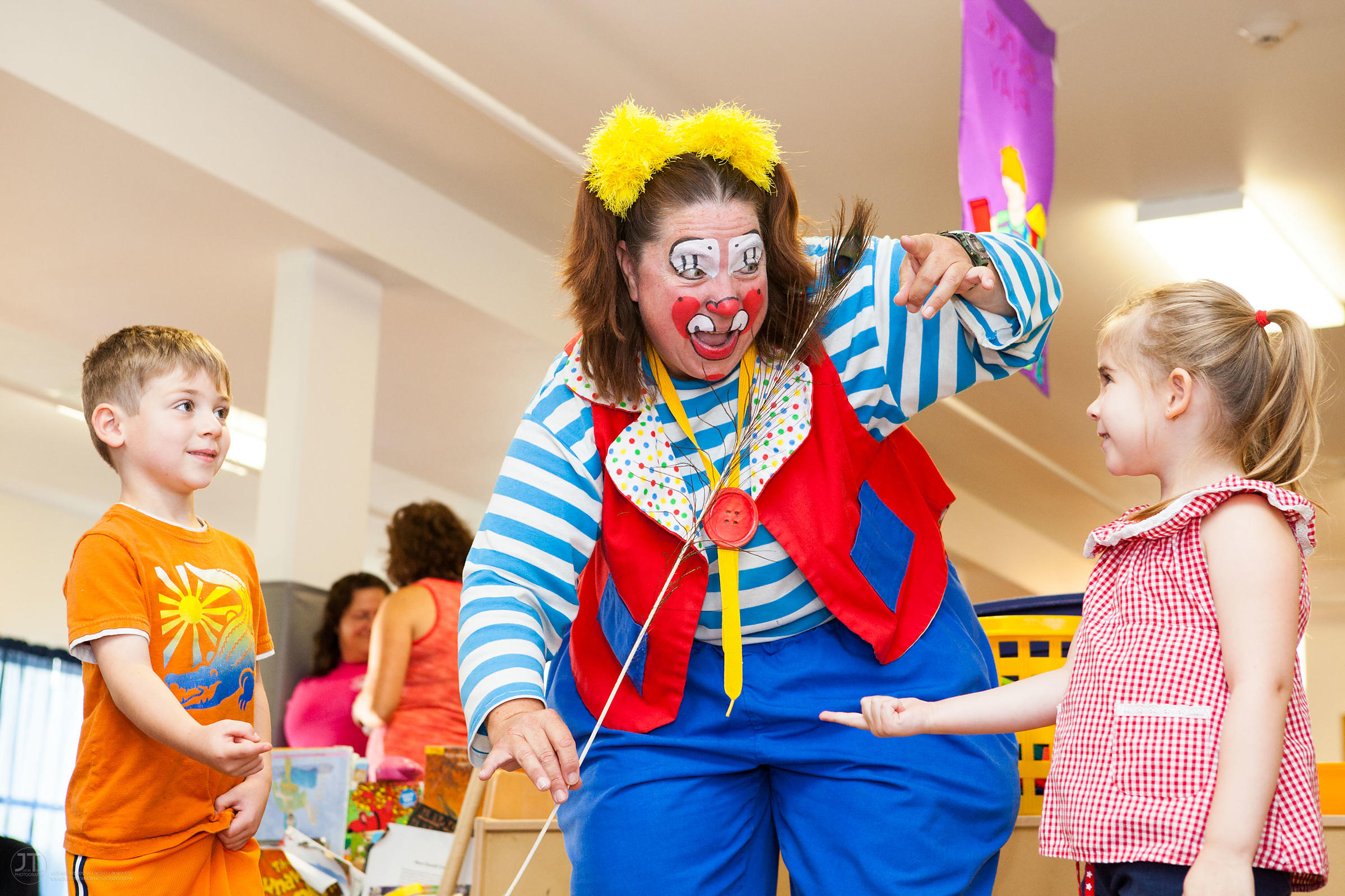Ms. Skeeter, a clown performer with the Culpepper-Merriweather Great Combined Circus teaches Ben Eshen, 5 and Corina Caracas-...