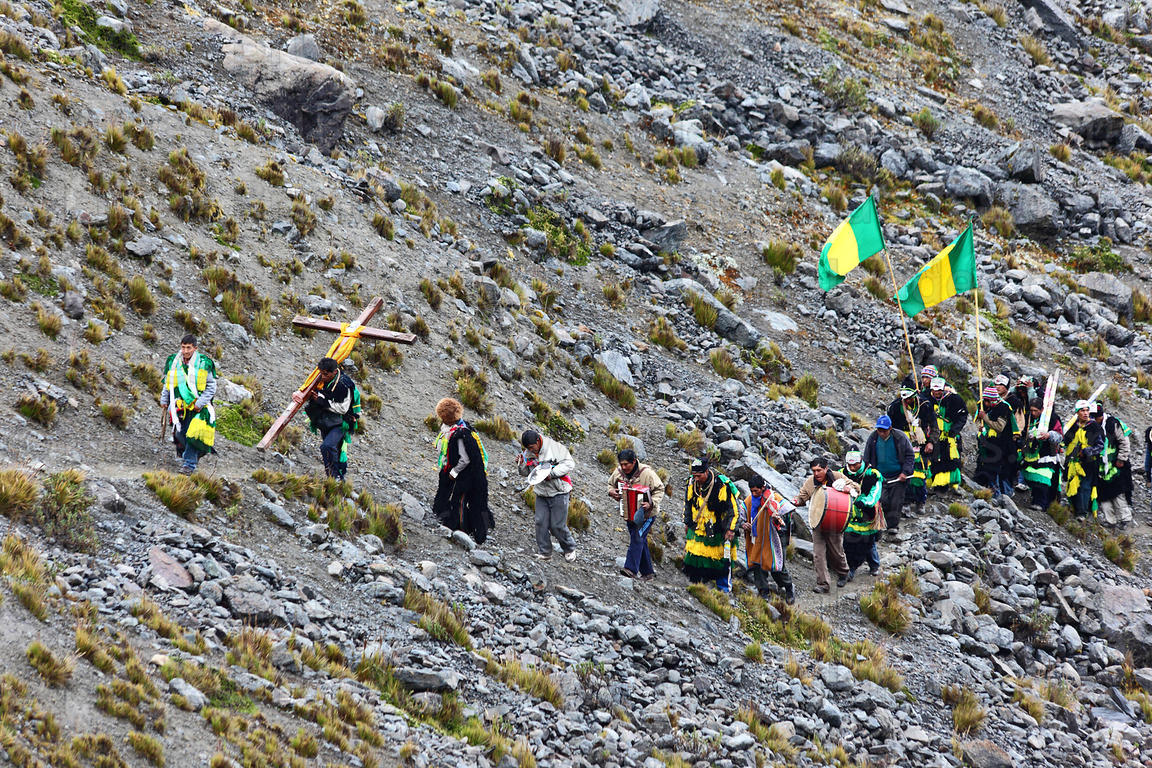 Spiritual leaders making pilgrimage up mountainside to glaciers during Qoyllur Riti festival, Peru