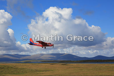 FIGAS (Falkland Islands Government Air Service) Britten-Norman Islander Aircraft VP-FBM coming in to land at Saunders Island,...