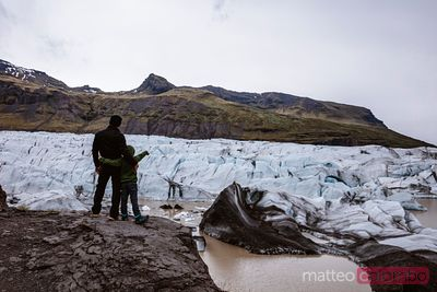 Man and child at Svinafellsjokull glacier in south Iceland