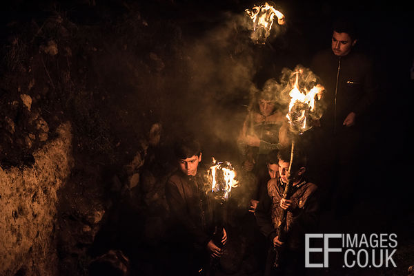 Kurdish Boys With Newroz Torches Making Their Way Down A Mountain In Akre