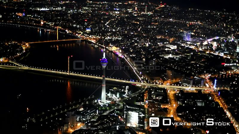 Night aerial video Cityscape on the bank of the river Rhine in Dusseldorf in the state Nordrhein-Westfalen, Germany