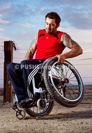 Man in a wheelchair tackling offroad trails