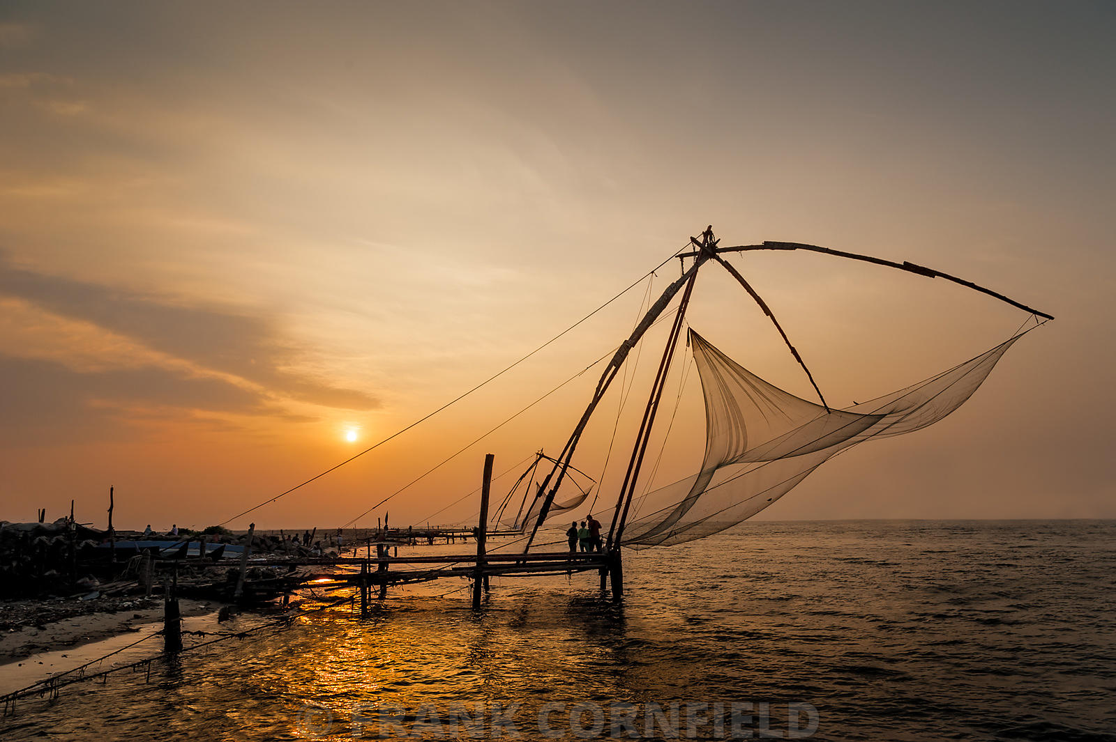 Chinese fishing nets in Cochin at sunset.