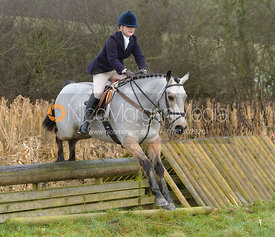 jumping a hunt jump at Peakes - The Fitzwilliam Hunt visit the Cottesmore at Burrough House
