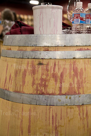 Oak barrel covered with spilled red wine