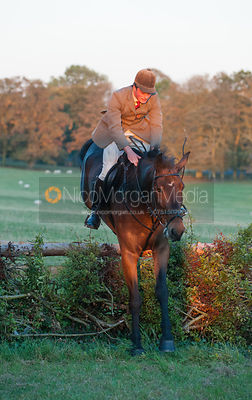 Jack Bevan jumps a hunt jump while Autumn Hunting with the Fernie Hunt.