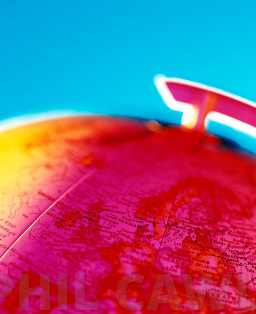 colourful abstract detail of a Globe on bright blue background