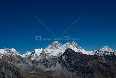 NEPAL Gokyo Peak -- Mount Everest (centre 8848m) dominates this view from Gokyo Ri. Beside it on the right is Mount Nuptse (7...