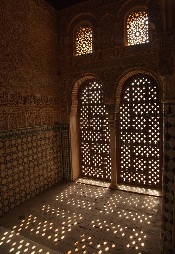 Dappled sunlight on the floor through the window at Alhambra palace