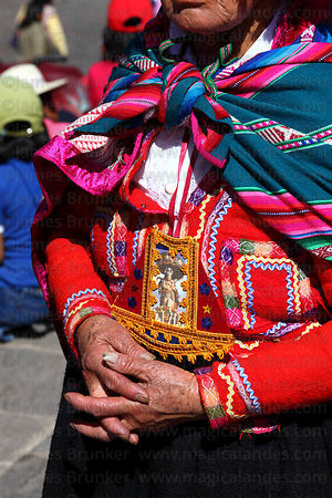 Indigenous devotee praying during Corpus Christi festival , Cusco , Peru