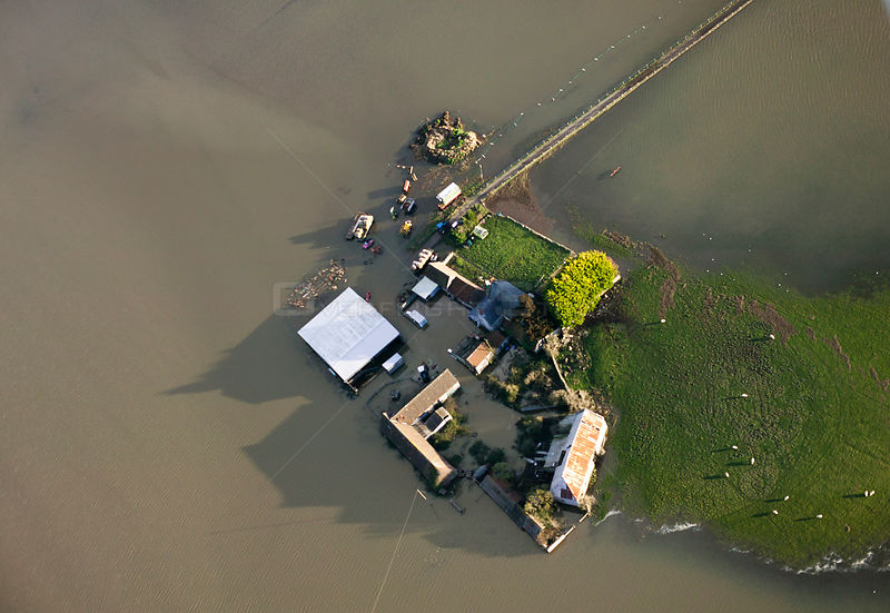 Farm surrounded by extensive January 2014 floods in Somerset Levels, near Langport, England, UK, 9th January 2014.