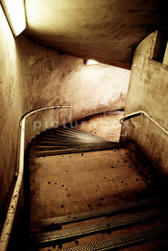 An atmospheric image of a some dirty, old characterful steps leading underground, London, England.