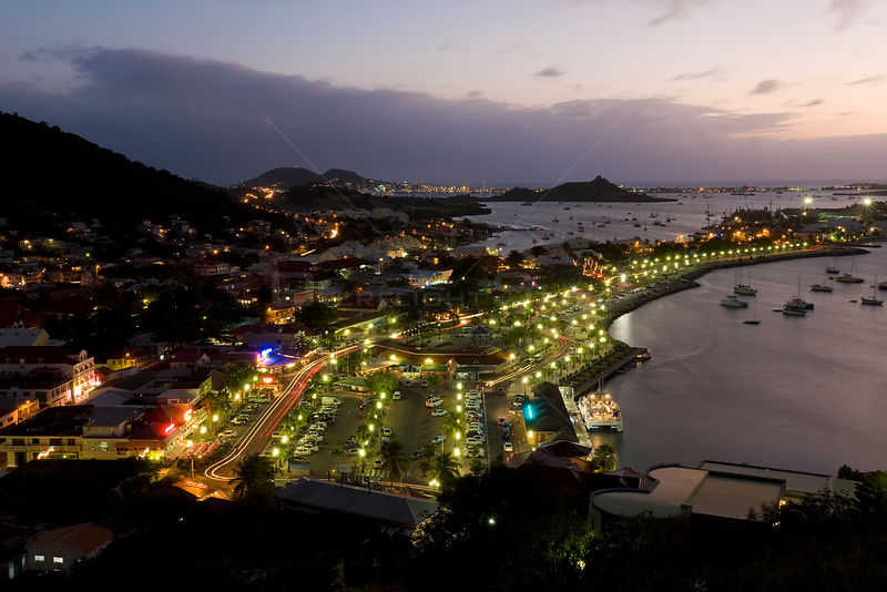 Elevated view over the French town of Marigot from Fort St. Louis at dusk, St Martin, Leeward Islands, Lesser Antilles, Carib...