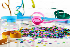Confetti and serpentines over a white background