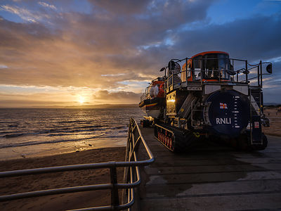 Dramatic winter sunset at the RNLI Station, Lifeboat ready for action, Exmouth, Devon, UK