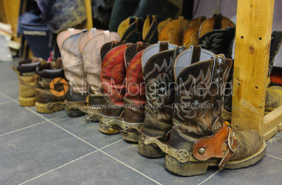 Stock photo of cowboy boots in a reining tack room