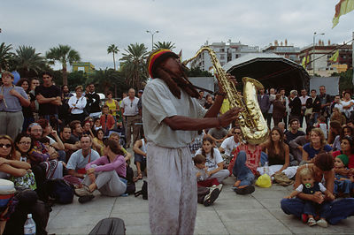 Saxaphone player entertains a crowd