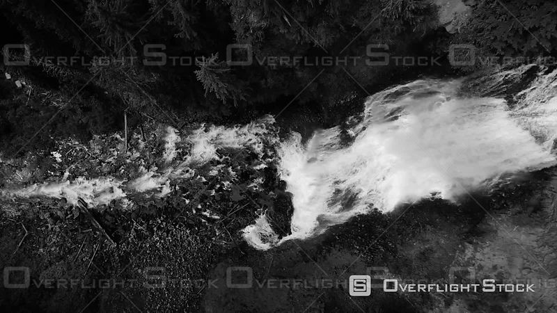 Monochrome drone shot of cascading waterfall at Alexander Falls in British Columbia