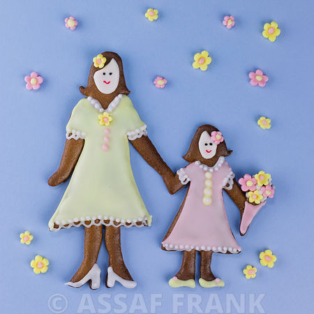 Gingerbread mother and child on blue background