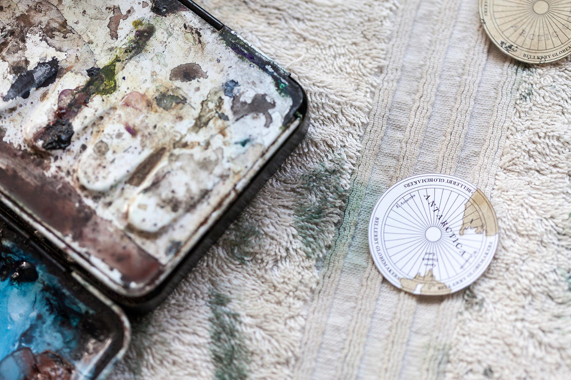 UK - London - An artist's paint palette, and globe detail, Bellerby and Co. Globemakers