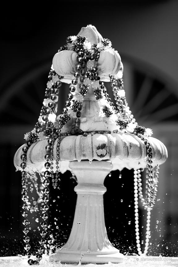 FOUNTAIN WITH BEADS FRENCH QUARTER NEW ORLEANS LOUISIANA BLACK AND WHITE VERTICAL