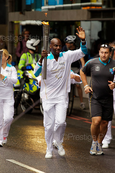 Paralympic Torch Bearer running in Lambeth, London