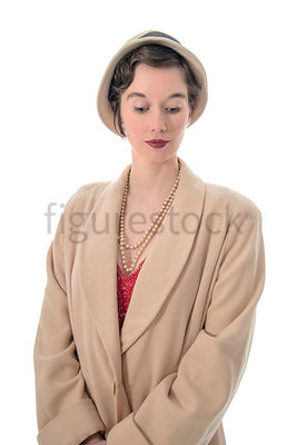 A vintage 1920s - 1930s woman in a big coat and hat – shot from eye level.