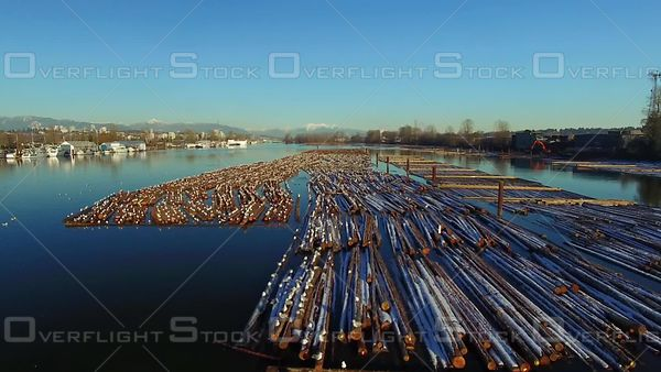 Log Booms on the Fraser River. British Columbia Forestry Industry.
