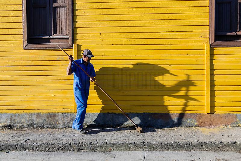 Man Sweeping Streets in the Early Morning
