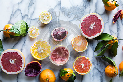 Citrus fruits. Grapefruits and oranges on marble background.