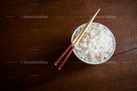 Rice bowl viewed from above with chopsticks backed