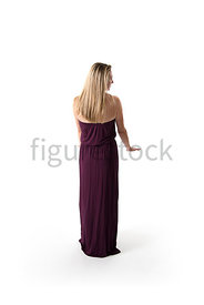 A Figurestock image of a blonde woman, in an evening dress, looking out, from a balcony or cruise ship - shot from eye level.