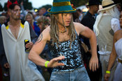 UK - Standon - A man dances in a field to a mobile sound system at the Standon Calling Festival