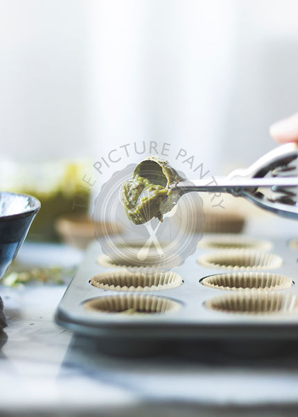 Salted chocolate pistachio butter cups. Ingredients placed in to baking tray.