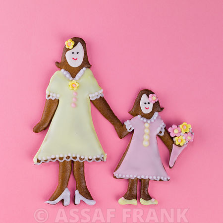 Gingerbread mother and child on pink background