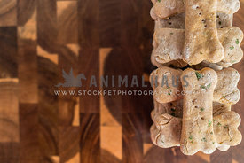 stacked dog biscuits on wood background